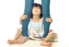 Asian little girl hugging mother's leg and looking up her mother Stock Photography