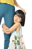 Asian little girl hugging mother's leg royalty free stock photos