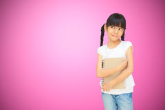 Asian little girl huging notebook Royalty Free Stock Images