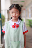 Asian little girl in kindergarten in Thai student uniform smiling with happiness stock photos