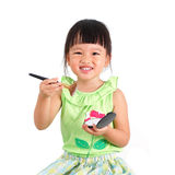 Asian little girl learning to make up Royalty Free Stock Photo