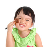 Asian little girl learning to make up Stock Image