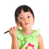 Asian little girl learning to make up Stock Photography