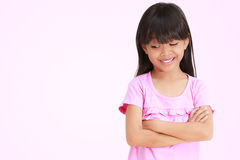Asian little girl looking down Royalty Free Stock Images