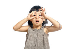 Asian little girl looking through imaginary binocular isolated o. N white background Stock Photos