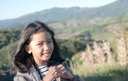 Asian little girl making heart shape and smiling stock photography