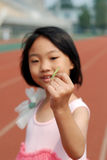 Asian little girl and mantis Royalty Free Stock Photos