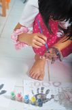 Asian little Girl Painting On Her Hand Royalty Free Stock Photography