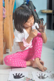 Asian little Girl Painting On Her Hand Royalty Free Stock Images