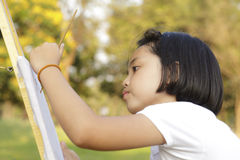 Girl painting in in the park Royalty Free Stock Images