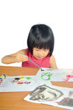 Asian little girl paints pictures with color brush Stock Photography