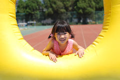 Asian little girl playing Royalty Free Stock Photos