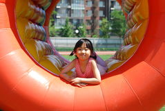 Asian little girl playing stock photography