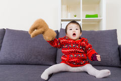 Asian little girl playing doll bear Stock Photo