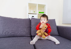 Asian Little girl playing doll at home Stock Photography