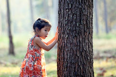 Asian little girl is playing hide-and-seek Royalty Free Stock Images