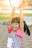Asian little girl playing at playground Stock Photos