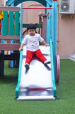 Asian little girl playing slider at playground thailand Royalty Free Stock Photos
