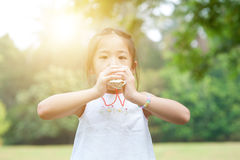 Asian little girl playing toy at outdoors. Royalty Free Stock Photos