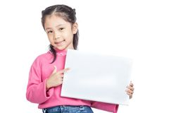Asian little girl point to a blank sign and smile Stock Photo