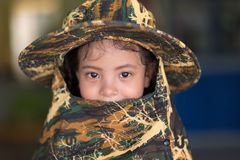 Asian little girl portrait with camo hat stock photos