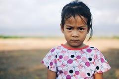 Asian little girl portrait  on the fields.  Stock Photos