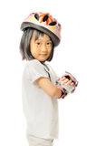 asian little girl in protective roller gear Stock Image