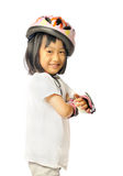 Asian little girl in protective roller gear on white background Royalty Free Stock Images