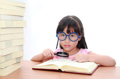 Asian little girl reading a book Stock Photo