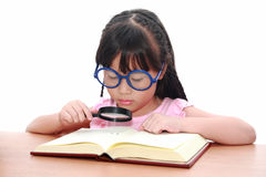Asian little girl reading a book Stock Image