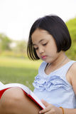 Asian little girl reading book Royalty Free Stock Photography