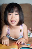 Asian little girl reading her book Royalty Free Stock Images