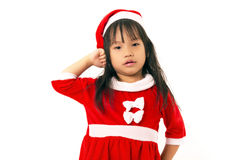 Asian little girl in red santa and red hat Stock Image