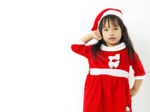 Asian little girl in red santa and red hat Stock Photos
