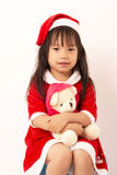 Asian little girl in red santa and red hat Stock Photo