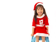 Asian little girl in red santa and red hat Stock Photography