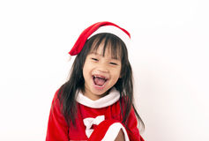 Asian little girl in red santa and red hat Stock Images