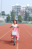 Asian little girl riding a bicycle stock image