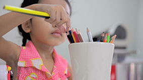 Asian little girl select the pencil color focus on pencil stock footage