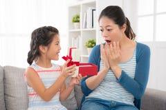 Free Asian Little Girl Sending Gift Red Ribbon Gift Box Stock Images - 91571794