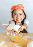 Asian little girl showing the bread Stock Photography