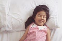 Asian little girl sleeping in bed. Asian little girl sleeping in bed Royalty Free Stock Image