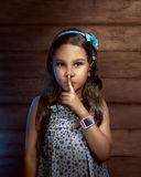 Asian little girl with smartwatch. Little girl wearing smartwatch on her arm Royalty Free Stock Images
