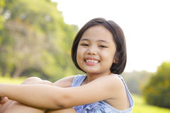 Girl smiling happily in the park Stock Photo