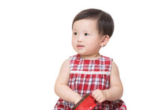 Asian little girl with snack box Royalty Free Stock Photography