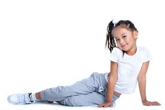 Asian little girl in sportswear sitting on floor Stock Photos
