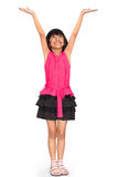 Asian little girl standing and holds hands up Stock Photo