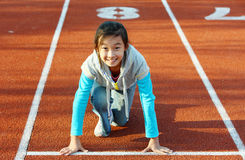 Asian little girl starting running Royalty Free Stock Photos