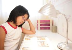 Asian little girl studying at home Stock Photo