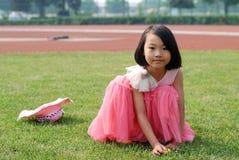 Asian little girl In summer garden stock photo